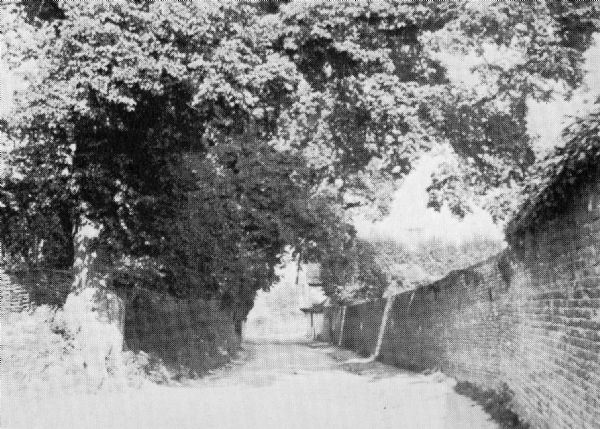 Wall to the Manor House & Church Cottage